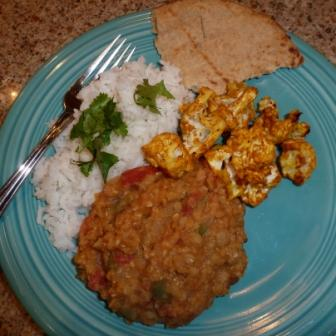 Spicy lentil dahl. roasted cauliflower, rice and naan