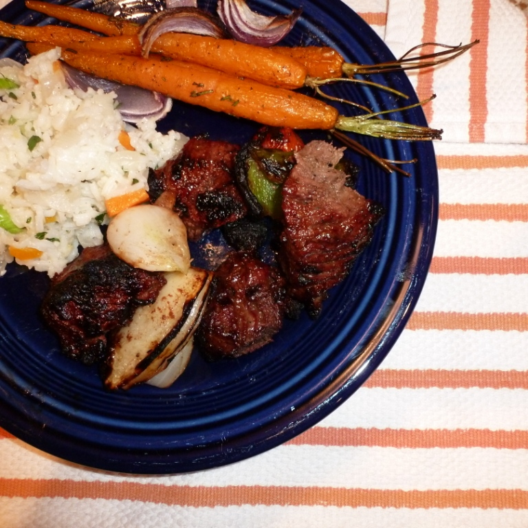 Beef kabobs, roasted bady carrots and rice