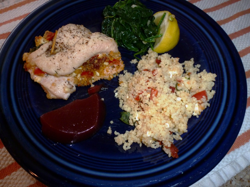 Stuffed Chicken with sauteed spinach and couscous