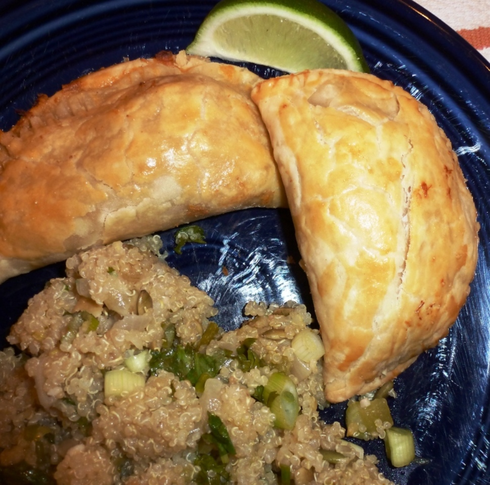 Empanadas, served with a quinoa dish with cilantro, lime and green chilies.